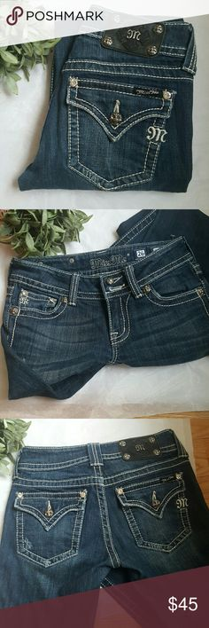 """Miss Me Boot Cut Dark Blue Jeans Stylishly distressed throughout. Flap back pockets with thick stitching. Low rise. These have been professionally hemmed. Inseam 29"""" Rise 7"""" Waist 12.5"""" Wash is labled dark 16  Style JP4009-2 Excellent pre-loved condition. Miss Me Jeans Boot Cut"""