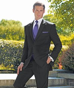 What color goes best with purple and black suit?