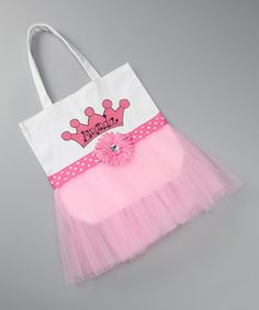 This personalized tutu tote adds a darling dash of whimsy and uniqueness to any petite outfit. With its durable canvas exterior and delicate tuft of tulle, it stores all the knickknacks from a full day's play.