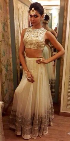 Deepika wearing a Arpita Mehta mirror work crop top and lehenga for one of her film promotion.: