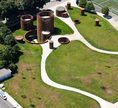 Interactive museum of the history of Lugo, Galicia, Spain. The round towers resemble roman towers. Architecture Building Design, Green Architecture, Futuristic Architecture, Sustainable Architecture, Landscape Architecture, Landscape Design, Museum Architecture, Contemporary Skylights, Underground Building