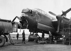 """Nick the Nazi Neutralizer"", a Lancaster III of No 463 Squadron, RAAF, being rearmed and refuelled at Waddington in early December 1944"
