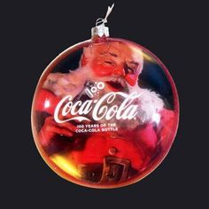 Decorate your Christmas with this shiny round disc Santa ornament made by Kurt Adler. Check out more of Adler's ornaments here www.2collectcola.com/cocacola/kurtadler.html