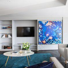 The Block Octagon: Living room week: Love the sliding artwork panel to hide the TV