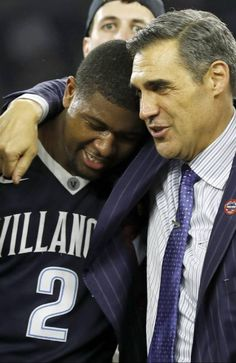 Villanova head coach Jay Wright, right, embraces Kris Jenkins after Jenkins scored a game winning three point basket in the closing seconds of the NCAA Final Four tournament college basketball championship game against North Carolina, Monday, April 4, 2016, in Houston. Villanova won 77-74. (AP Photo/David J. Phillip)