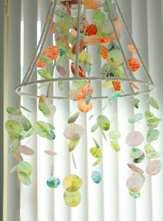 Wax Paper & Crayon Chandelier: a fun and inexpensive #DIY ! http://www.theletter4.com/  Shave crayons between two pieces of wax paper, iron, and cut out shapes. Then attach them to fishing line and hang them on a old lamp shade. (pretty cool)