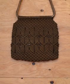 ITEM DESCRIPTION Style.... BOHO, Hippie, Pouch Satchel style, macrame-type woven purse Label.... None Material.... Synthetic woven cord, and