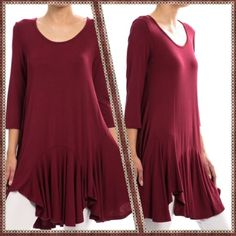 TUNIC WITH FLARED SKIRT - SIZE LARGE Super soft, yet well constructed; dress it up or down; wear as dress or tunic over tights/leggings/jeans.  Available in 3 colors : BURGUNDY, BLACK, ROYAL BLUE. Sizes: S/M/L  95/5 Rayon/Spandex, Length is 34 inches long, made in USA. price is FIRM, unless bundled. NO TRADES. This listing is for a LARGE in BURGUNDY Rouge Skirts