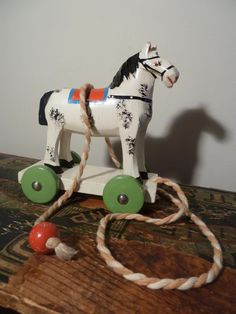 Antique Hand Carved Hand Painted Wooden Horse Pull Toy $23.00 #horse #pull-toy #christmas #handmade #carved #wood #wheels #green #white #red #decoration #antique #toy #vintage #etsy