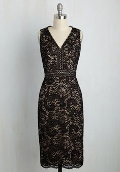 By strutting onto the dance floor in this black dress, you'll make quite the stir - of compliments! With each one-two-step, the scalloped V-neck, banded waist, and paisley lace design of this sultry sheath attracts smiles and swoons from every other lady in the room!