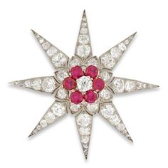 A Victorian ruby and diamond star brooch