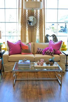 boring sofa upgrade - bright throw pillows are just the trick!