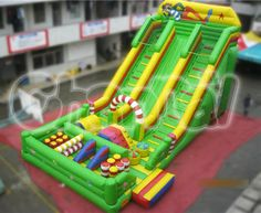The ultimate fun is all here in this green and yellow clown themed obstacles inflatable slide, kids can slide and play obstacles meanwhile. Inflatable Slide, Nerf