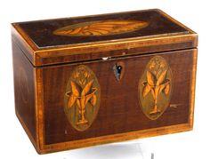 A George III inlaid mahogany tea caddy.