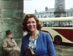 Horse Sense (1978) Market Place, Richmond, North Yorkshire - Helen looks on after giving James directions to Skeldale House in this first episode.
