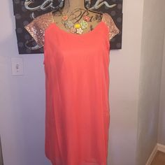 Fun, flirty summer dress, in orange w/ gold sequin This dress runs small. Sheer orange body with gold sequined cap sleeves. The dress is lined with another sheer stretchy lining. Measures 31in from shoulder to hem, 18in across the bust,  and 21in across the hip. Dresses Mini