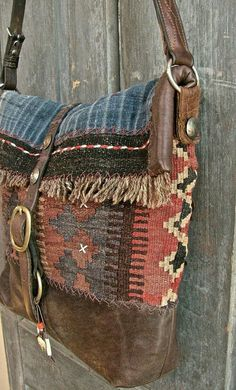 kinda lovin' this.The Buffalo bag messenger bag. Vintage kilim, Hmong indigo, bridle leather and old coins. Fully lined with African mud cloth. Estilo Hippie, Hippie Chic, Hippie Style, Boho Style, Tribal Style, My Bags, Purses And Bags, Look Boho Chic, Indigo
