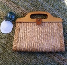 Check out this item in my Etsy shop https://www.etsy.com/listing/222256679/retro-woven-straw-purse-vintage-braided