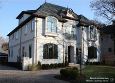 Our Design Inspiration: French Chateau Architecture  Our clients are in the midst of completing a major exterior remodeling project, transforming their markedly tutor-styled home into a French Chateau-inspired look.  Read more on our blog: http://wp.me/p4XhWn-m7