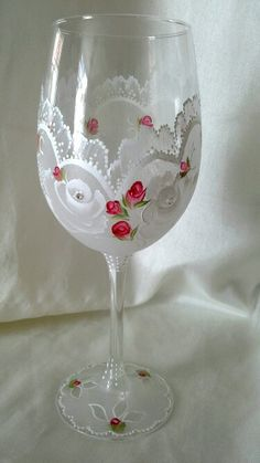 Handpainted wine glass,  lacey  effect with roses , rosebuds  and Austrian crystals