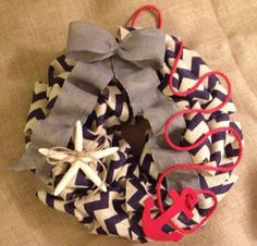 Handmade nautical wreath 16 inch chevron blue and white with gray bow with starfish, anchor, and red rope on Etsy, $42.00