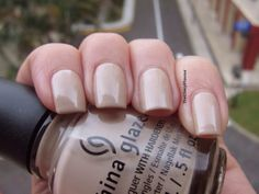 China Glaze Don't Honk Your Thorn is a light beige brown creme polish with very light silver shimmers.