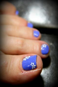 Pretty pedicure: blue polish with white flowers