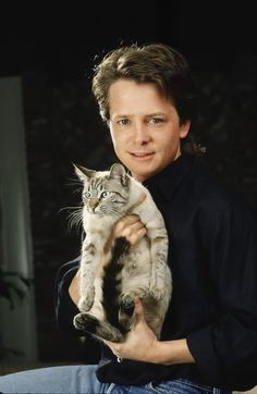 Michael j fox holding this cat is pretty much the best thing I have seen in a while. I love him forever for it. <3