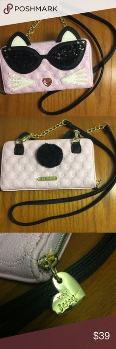 Betsey Johnson Pink Cat Wallet on a String Sweet Betsey Johnson wallet on a string. NWOT Never used. The plastic is still on the Betsey logo on the back. The gem nose has hair line scratches on it maybe from storing. Tried to show in photo. Baby pink and the most adorable wallet / crossbody ever! Fits an iPhone 6+. It's just lonely at my house sitting in the closet. Give this kitten a new home! Betsey Johnson Bags Clutches & Wristlets