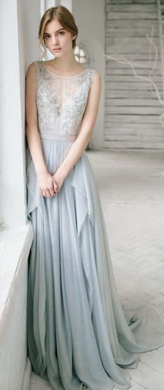 Pretty blue bead embroidered illusion bodice wedding dress; Featured Dress: CarouselFashion