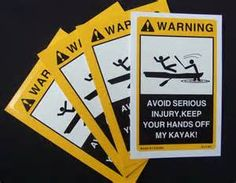 Warning:  Avoid serious injury - keep your hands off my kayak!