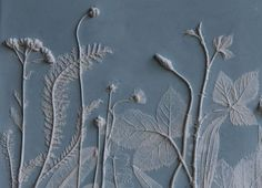 This tile is one of a series from Rachel Deins Tactile Studio. To make the tile, Rachel laid flowers and foliage on to a rolled-out slab of clay