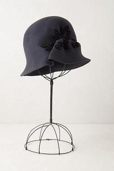 Ah to live in an era when hats like this were in fashion. Or had a job where I could wear things like this.    Lewes Cloche #anthropologie