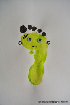 Frankenstein Footprint and Handprint Art- classic Halloween crafts for kids