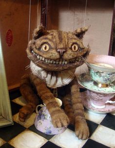 Cheshire Cat marionette - my GOD that is terrifying.
