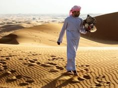 Emirati with a falcon in Abu Dhabi