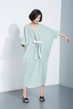 Lightweight and low maintenance, crisp and cooling linen is a getaway must. This mint linen dress is the ultimate suitcase essential. Youll be able to build your capsule holiday wardrobe around this loose-fitted casual or smart dress. Crafted from pure linen, the dress feels luxuriously