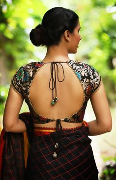 The wedding season is here! Ready to rock the wedding season with the mesmerizing and stylish blouse designs? Not only the bride every girl wants to look at their ethnic best at weddings. Blouse Back Neck Designs, Black Blouse Designs, New Saree Blouse Designs, Saree Jacket Designs, Blouse Designs Catalogue, Simple Blouse Designs, Stylish Blouse Design, Indian Blouse Designs, Blouse Designs Wedding