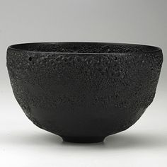 "OTTO AND GERTRUD NATZLER; Hemishperical bowl with very rare black volcanic glaze, Los Angeles, CA, 1960s; Signed NATZLER, label H518; 4"" x 6 1/2""; Note: A rare example in this glaze; Estimate: $5,000 - $7,500; Winning bid- $10,000"