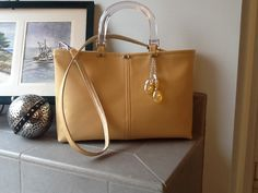 """My newest creation!  This bag, named """"All Dressed Up"""" is a golden butter colored, super soft vinyl accented with glass beads, Lucite handles, and a detachable shoulder strap.  Fully lined with interior pockets, key fob, and magnetic snap closure.  Have a look at Bobbin My Thread on Facebook to see this and more handbags designed by Nena!"""