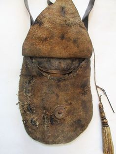 Hemp body, brain tan deer flap bag with buffalo horn.  Attached wire and antler measure that holds 50 grains.  One inside pocket of d...