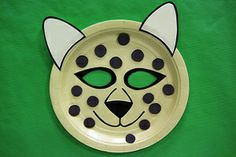 Create a paper plate cheetah mask and turn into the fastest land animal. Cut spots out of craft foam, glue them on a yellow paper plate, cut and glue on ears, and cut out eyes. Paper Plate Animal Masks, Animal Masks For Kids, Mask For Kids, Vbs Crafts, Foam Crafts, Preschool Crafts, Craft Foam, Older Kids Crafts, Craft Activities For Kids