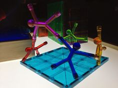 magnetic men, window blocks, and magna tiles on the light table