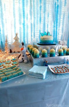 Our Frozen Dessert Table was filled with yummy Frozen-themed sweets for our Frozen Birthday Party guests.  It was also a sparkling and spectacular Frozen party decoration. For more fun Frozen Party Ideas follow us at http://www.pinterest.com/2SistersCraft/
