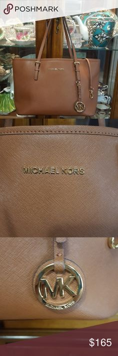 Authentic Michael kors Carmel handbag Wore only one time like new mint condition, gold hardware, can be dressed up or down, no strains, absolutely adorable 5 pockets inside , small to medium in size Michael kors  Bags Shoulder Bags