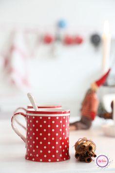 Good morning with polka dots mug and cinnamon coffee.