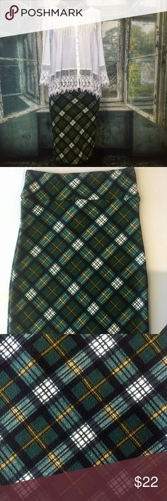 Agnes and Dora plaid pencil skirt 417 Agnes and Dora pencil skirt. I used to be a A&D rep. These skirts have a comfortable yoga waistband. Can be dressed up or down. 97% polyester and 3% spandex. Wash inside out on delicate cycle and hang to dry. Measurements taken flat and in inches. Waist 141/2. Hip 16. Length 253/4. Colors are forest green, white, black, and a thin stripe of mustard yellow. Agnes & Dora Skirts Pencil
