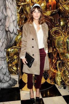 Burgundy trousers white top camel coat
