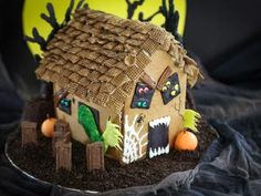 A Haunted Gingerbread House for your Halloween Party! I like the Chex cereal roof shingles! I wonder if melted chocolate or peanut butter would work for sticking to the roof?