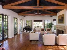 Love the beams against the dark ceiling, windows and white walls